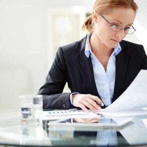 Business woman looking at documents