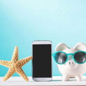 a starfish, cell phone, and piggy bank with sun glasses